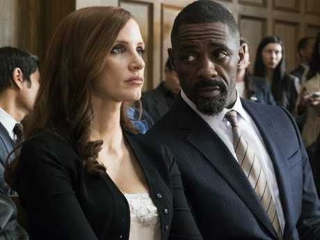 Jessica Chastain and Idris Elba in a scene from Molly's Game. Picture: Supplied