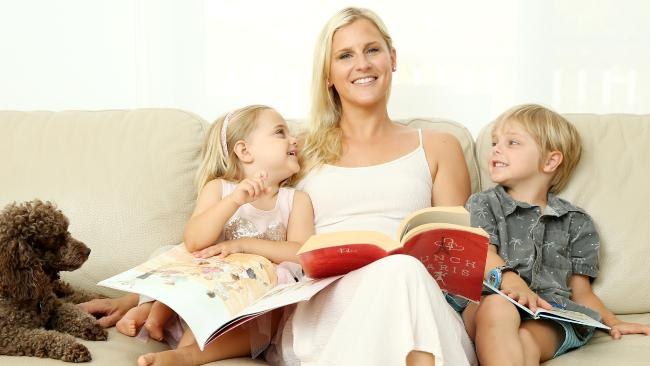 SUNDAY TELEGRAPH — Pictured at home in Newport today is Nyssa Carter, reading with her kids Mason 5 and Charlotte 3. Picture: Tim Hunter.