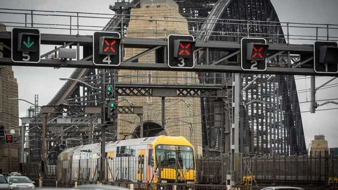 Trains approach Milsons Point railway station in the Sydney suburb of Milsons Point on Thursday, January 25, 2018. Sydney commuters faced delays as trains ran on a Saturday timetable due to industrial action by rail workers.