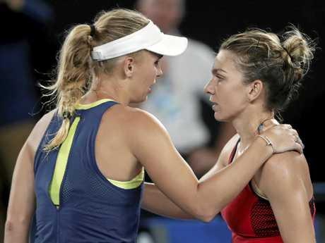 Simona Halep, right, congratulates Caroline Wozniacki.