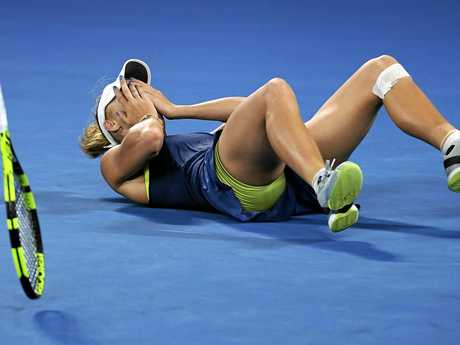 Caroline Wozniacki collapses on court after winning the women's singles final.