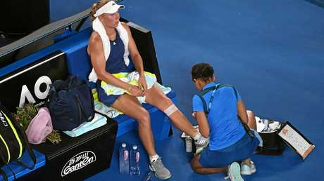 Caroline Wozniacki receives treatment for her injured knee during the final.