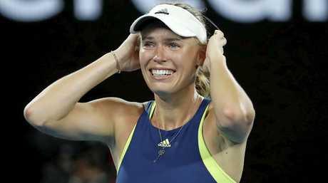 Caroline Wozniacki reacts after claiming the women's singles final.