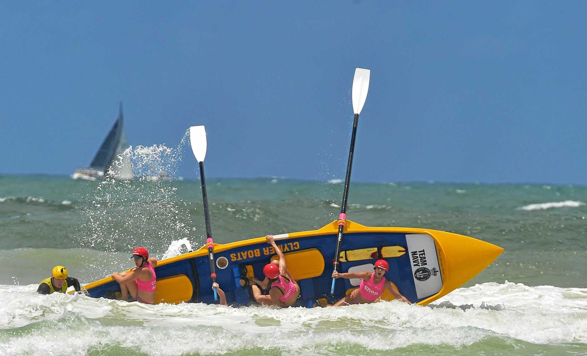 The Coolum Women's boat crew try to hang on in rough conditions at tyhe 2018 Murphy Homes Maroochy Carnival .