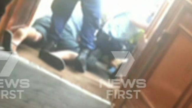 Police subdue a man at the Maroubra Hotel.