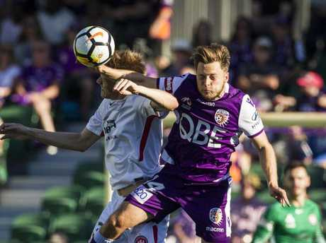 Jack Clisby of the Western Sydney Wanderers and Chris Harold of the Perth Glory contest the ball.