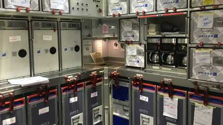 Chicken or beef? Inside the galley on the flight. Picture: Supplied