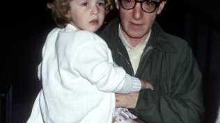 Dylan Farrow as a child with her adoptive father Woody Allen.