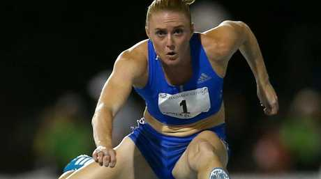 Sally Pearson competes in the women's 100 metre hurdles during the Jandakot Airport Perth Track Classic at WA.