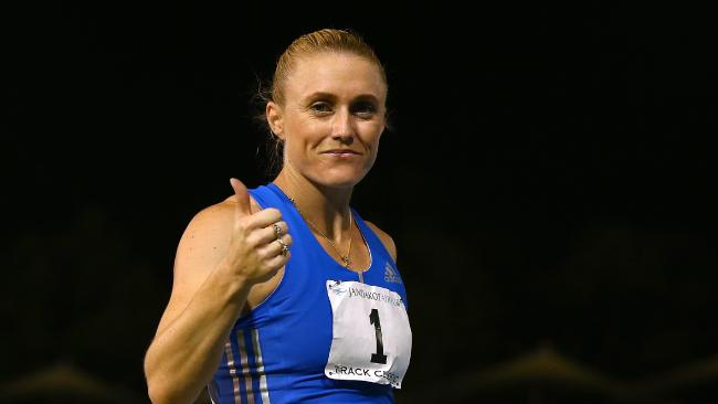 Sally Pearson acknowledges the spectators after competing in and winning the women's 100 metre hurdles during the Jandakot Airport Perth Track Classic at WA.