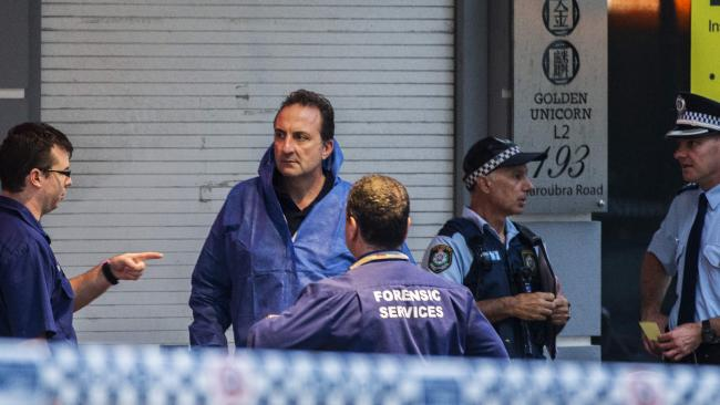 Forensic officers and police at the Maroubra Hotel. Picture: Jenny Evans