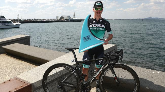 Jay McCarthy shows off the spoils of his Cadel Evans Great Ocean Road Race win. Picture: Getty Images