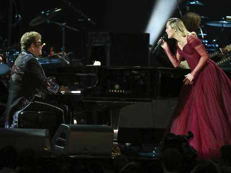Recording artists Sir Elton John and Miley Cyrus perform onstage during the 60th Annual GRAMMY Awards