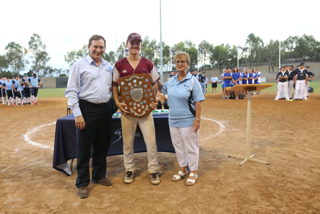 Queensland Under-19 Men's Softball captain Michael Ludkin proudly holds the Nox Bailey Shield after his side won the 2018 U19 Men's National Softball Championship for the second year in a row.