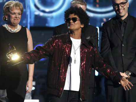 Bruno Mars accepts the award for record of the year for 24K Magic at the 60th annual Grammy Awards at Madison Square Garden on Sunday, Jan. 28, 2018, in New York.