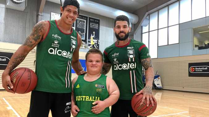 Cooper Whitestyles (ecntre), a huge Rabbitohs fan, spent time with Bunnies' stars Dane Gagai (left) and Adam Reynolds at the AIS in January, where he was part of Australia's Athle Development camp for wheelchair basketball's under-23 World Championships in 2021.
