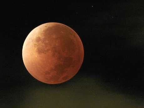 The moon will take on a blood-red tinge during a full eclipse tonight, coinciding with a blue moon and super moon in an incredibly rare event.