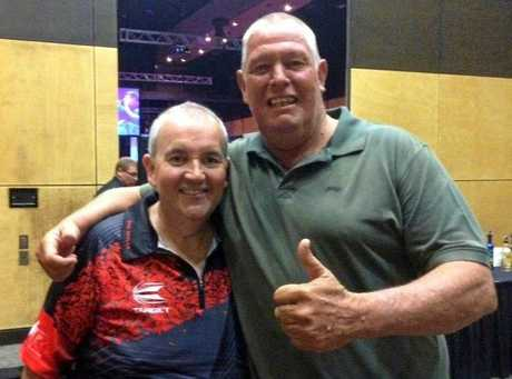 Alpha resident John White (right) drove eight hours to watch Phil Taylor (left) at the Pro Darts Showdown Series in Mackay