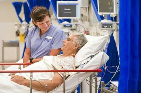 Nurse Heather Carfrae with patient Wayne Quinn.