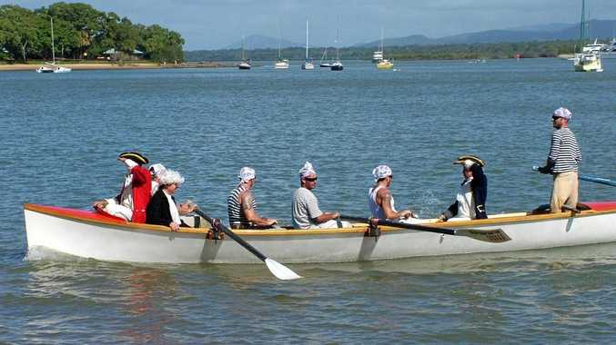 An undated image of 'Captain James Cook' coming ashore in his longboat in the re-enactment of his landing at the Town of 1770 on Queensland's Discovery Coast. This was Cook's first landing in what would become the state of Queensland. (AAP Image/David Potts)