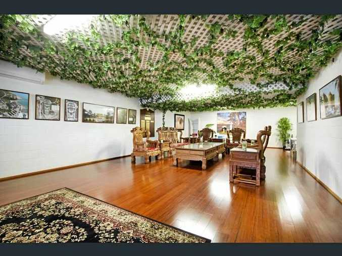 The Cannonvale house owned by Chinese billionaire Raymond (Peter) Wang has been listed for sale.