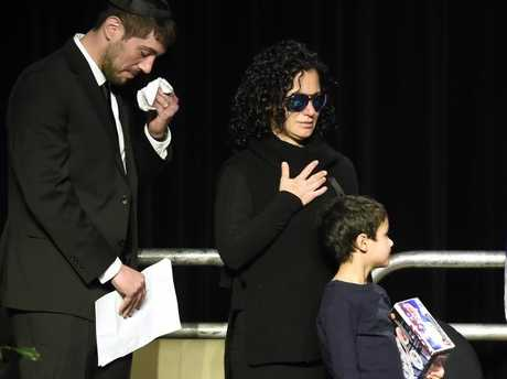 Jonathon Sherman and his sister Lauren weep during a December 21 memorial service in Mississauga, Ontario, for their parents Barry and Honey Sherman. Picture: Nathan Denette/The Canadian Press via AP