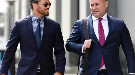 Queensland Reds rugby union player Karmichael Hunt (left) and his lawyer Adam Magill.