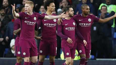 Manchester City players react after a goal.
