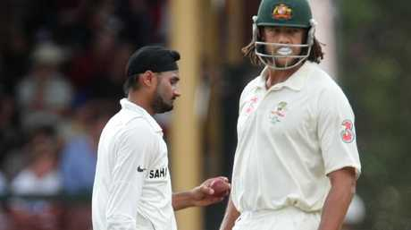 Harbhajan Singh walks past Andrew Symonds during the controversial 2008 Test.
