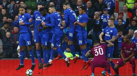 The Cardiff City wall jump as Manchester City's Belgian midfielder Kevin De Bruyne scores.