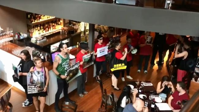 Protesters crash a Melbourne steakhouse.