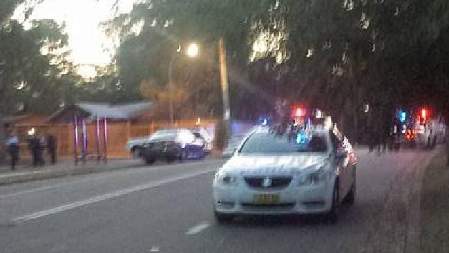 Emergency services at the scene, following the shooting.