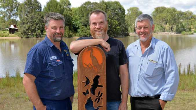 Kim Duff of Ironic Art, designer Steven Wilson and Lockyer Valley Councillor Michael Hagan around one of four new artwork installations at Lake Apex.