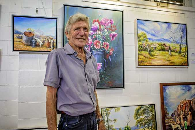 ON THE WALL: Jim Tozer preparing his art exhibition
