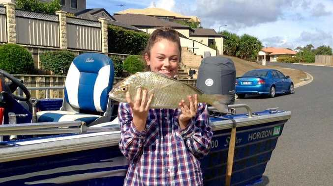 NICE FISH: Sarah Dunn went fishing with her Pop and was so excited when she caught this 60 cm, 2.7kg grunter.