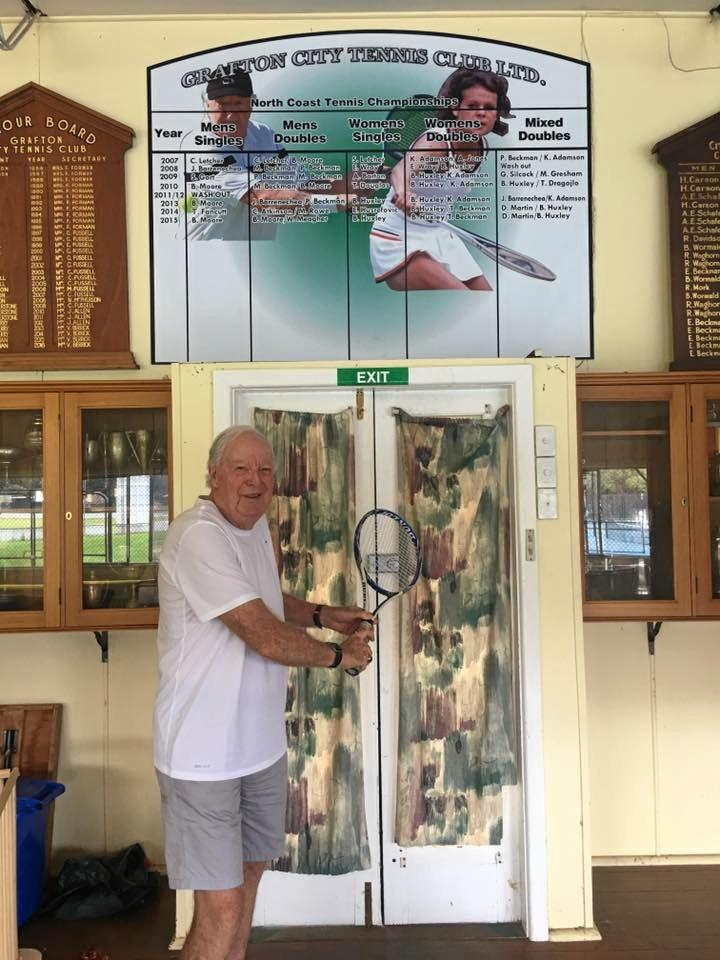 STILL GOT IT: Fred Stolle mimics his famous backhand at the Grafton City Tennis Club.