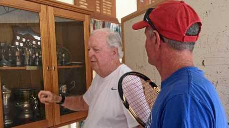 IMPRESSED: Grafton City Tennis Club coach Phil Beckman shows tennis great Fred Stolle the trophies the club has on display.