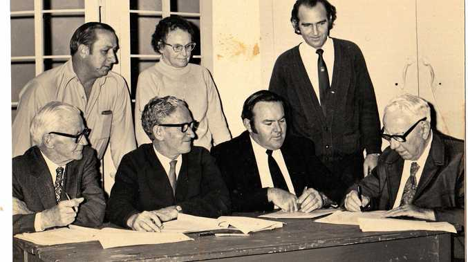 LET'S BUILD A THEATRE: Signing the Playhouse Theatre contract are president Gordon Dick (back left), artistic director Helen Cattermull, treasurer Ron Halpin along with committee member Bill Millar (front left), builder Joe Gaffney, committee member John Faircloth and vice-president Skip Cattermull.