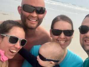 Dad fights for life after being 'buried alive' by sand dune