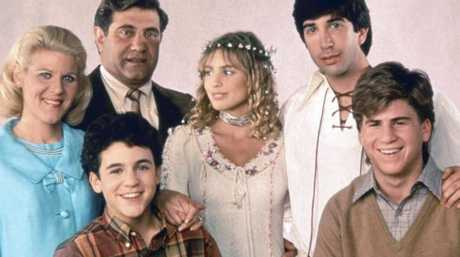 The cast of The Wonder Years in 1992, from left: Ally Mills, Dan Lauria (rear), Fred Savage, Olivia d'Abo, David Schwimmer, Jason Hervey. Picture: Alamy