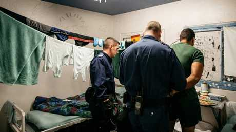 Prison officers detaining inmate during a prison cell raid at Silverwater. Picture: Jonathan Ng