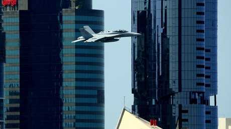 EA-18G Growler jet during a fly by of the Brisbane CBD. Picture: Liam Kidston.