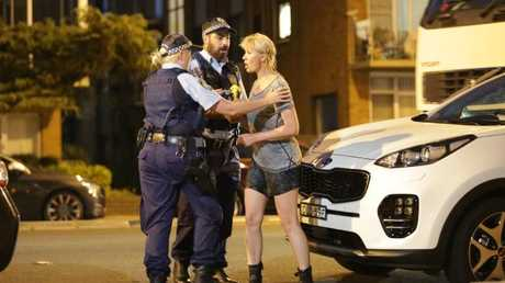 A woman is comforted by police after the man, believed to be in his 30s, drowned yesterday. Picture: Christian Gilles