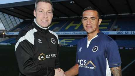 Former teammates Neil Harris (current manager) and Tim Cahill reunite.