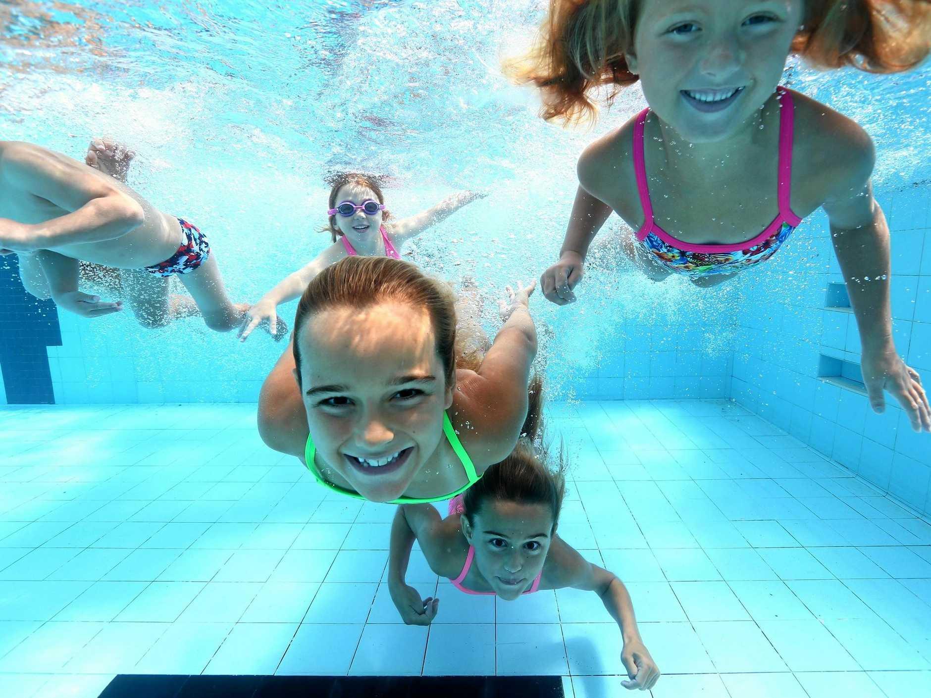 In centre Ryne Spence, 9, having some fun at Miami Aquatic Centre for News Corp Swimming lesson campaign.