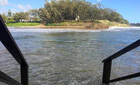 HIGH TIDE: Waves crash into Moneys Creek.