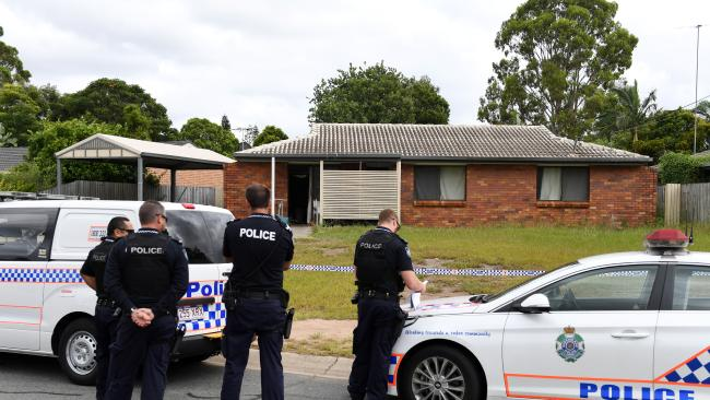 Police guard a house in which two bodies were found in Eagleby, south of Brisbane. Picture: AAP Image/Dan Peled