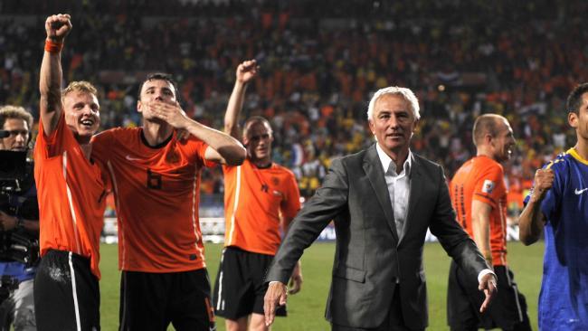Bert Van Marwijk (c) with Dirk Kuyt (l) and Mark van Bommel (2nd l).
