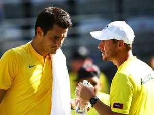 Tomic hits back at Hewitt