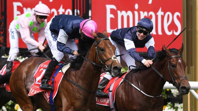 Corey Brown (centre) reacts after Rekindling beat Johannes Vermeer (right) ridden by Ben Melham in second and Max Dynamite third ridden by Zac Purton in the Melbourne Cup at Flemington Racecourse in Melbourne, Tuesday, November 7, 2017. (AAP Image/Julian Smith) NO ARCHIVING